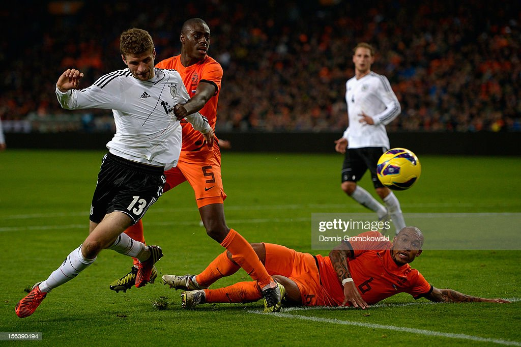 Bruno Martins Indi of Netherlands and teammate Nigel de Jong challenge Thomas Mueller of Germany during the International Friendly match between Netherlands and Germany at Amsterdam Arena on November 14, 2012 in Amsterdam, Netherlands.