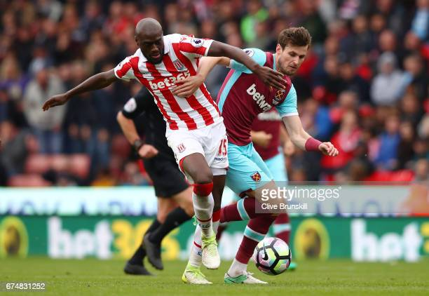 Bruno Martins Indi of Stoke City and Havard Nordtveit of West Ham United in action during the Premier League match between Stoke City and West Ham...