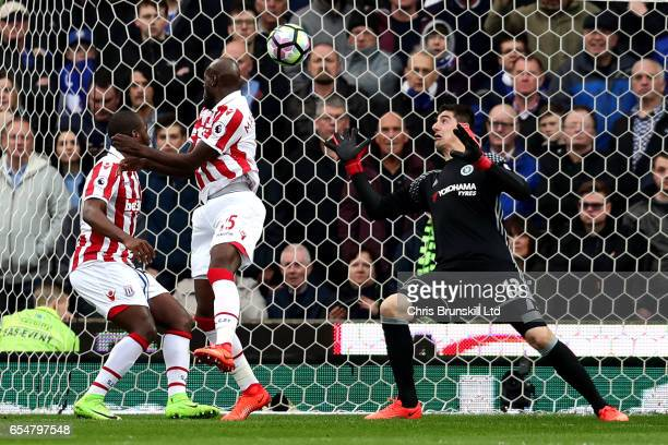 Bruno Martins Indi of Stoke City heads past Thibaut Courtois but it is ruled out for a foul during the Premier League match between Stoke City and...