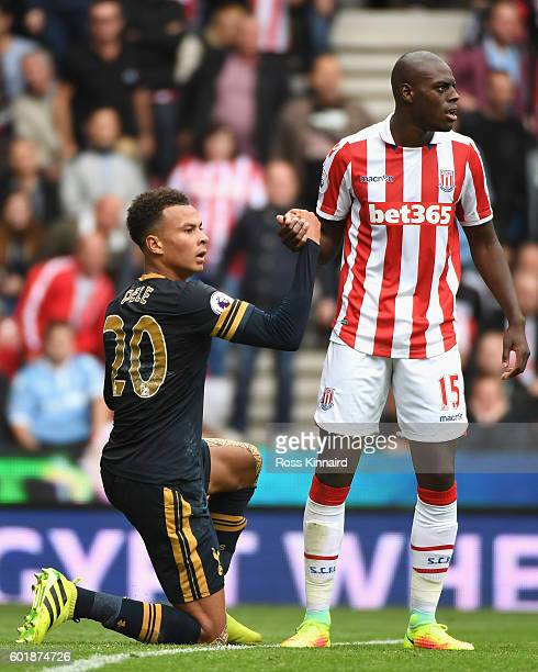 Bruno Martins Indi of Stoke City helps up Dele Alli of Tottenham Hotspur during the Premier League match between Stoke City and Tottenham Hotspur at...
