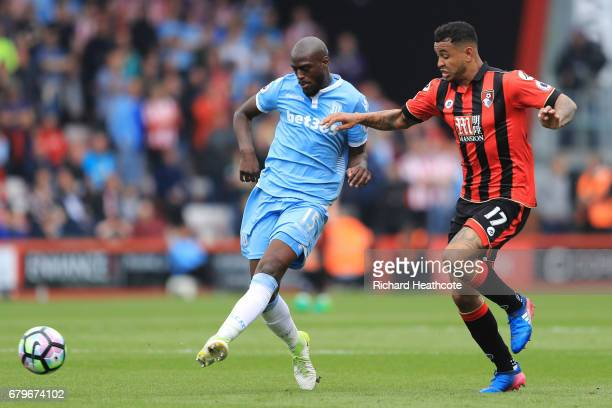 Bruno Martins Indi of Stoke City is put under pressure from Joshua King of AFC Bournemouth during the Premier League match between AFC Bournemouth...