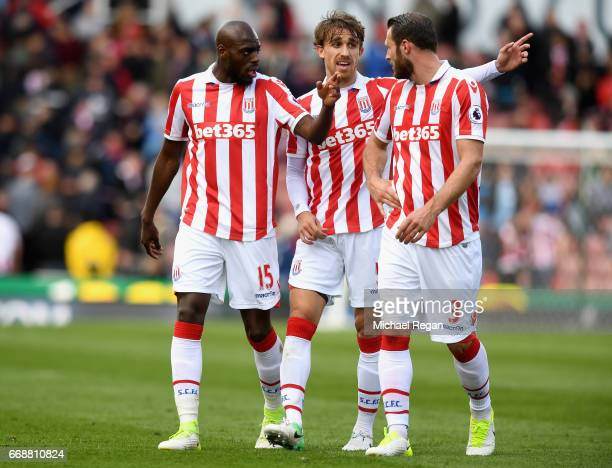Bruno Martins Indi of Stoke City Marc Muniesa of Stoke City and Erik Pieters of Stoke City speak to each other during the Premier League match...