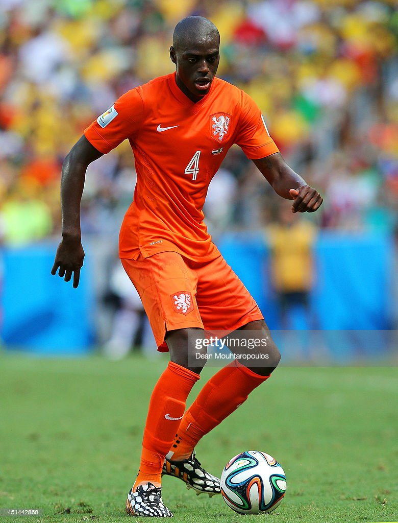 <a gi-track='captionPersonalityLinkClicked' href=/galleries/search?phrase=Bruno+Martins+Indi&family=editorial&specificpeople=7155940 ng-click='$event.stopPropagation()'>Bruno Martins Indi</a> of the Netherlands controls the ball during the 2014 FIFA World Cup Brazil Round of 16 match between Netherlands and Mexico at Castelao on June 29, 2014 in Fortaleza, Brazil.