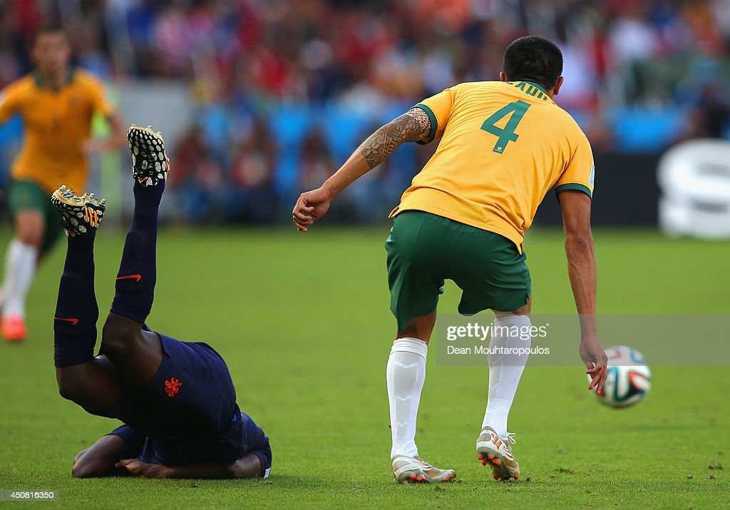 <a gi-track='captionPersonalityLinkClicked' href=/galleries/search?phrase=Bruno+Martins+Indi&family=editorial&specificpeople=7155940 ng-click='$event.stopPropagation()'>Bruno Martins Indi</a> of the Netherlands falls to the field after a challenge by Australia during the 2014 FIFA World Cup Brazil Group B match between Australia and Netherlands at Estadio Beira-Rio on June 18, 2014 in Porto Alegre, Brazil.