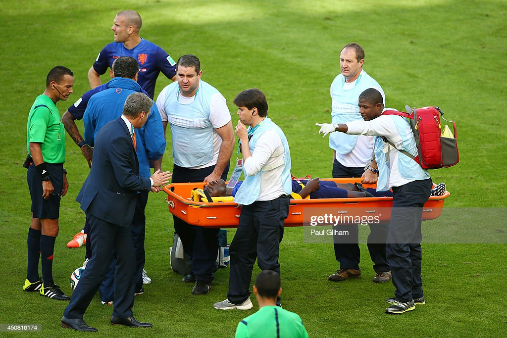 <a gi-track='captionPersonalityLinkClicked' href=/galleries/search?phrase=Bruno+Martins+Indi&family=editorial&specificpeople=7155940 ng-click='$event.stopPropagation()'>Bruno Martins Indi</a> of the Netherlands is stretchered off the field during the 2014 FIFA World Cup Brazil Group B match between Australia and Netherlands at Estadio Beira-Rio on June 18, 2014 in Porto Alegre, Brazil.