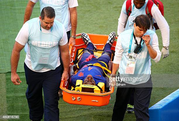 Bruno Martins Indi of the Netherlands is stretchered off the field during the 2014 FIFA World Cup Brazil Group B match between Australia and...