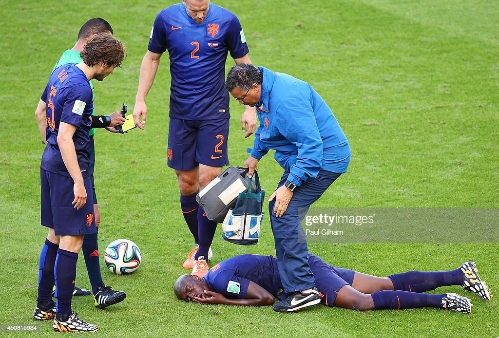 <a gi-track='captionPersonalityLinkClicked' href=/galleries/search?phrase=Bruno+Martins+Indi&family=editorial&specificpeople=7155940 ng-click='$event.stopPropagation()'>Bruno Martins Indi</a> of the Netherlands receives treatment after a challenge during the 2014 FIFA World Cup Brazil Group B match between Australia and Netherlands at Estadio Beira-Rio on June 18, 2014 in Porto Alegre, Brazil.