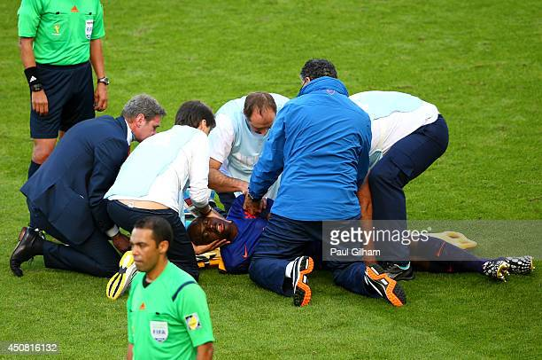 Bruno Martins Indi of the Netherlands receives treatment after a challenge during the 2014 FIFA World Cup Brazil Group B match between Australia and...