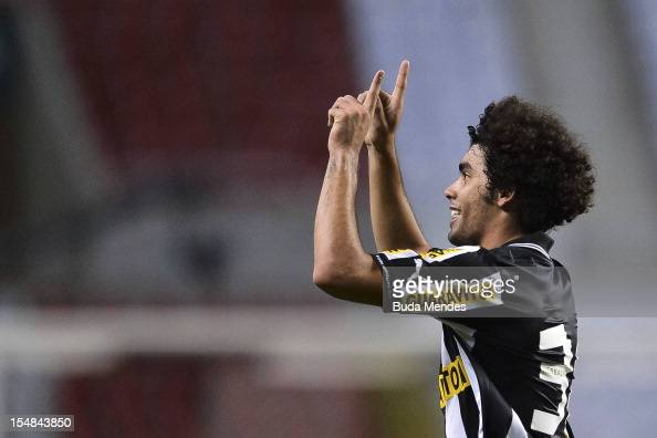 Bruno Mendes of Botafogo celebrates a scored goal against Atletico GO during a match between Botafogo and Atletico GO as part of Serie A 2012 at...