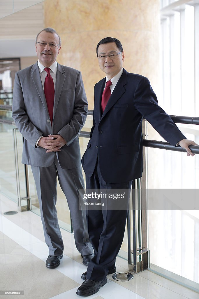 Bruno Mercier, chief executive officer of Sun Art Retail Group Ltd., left, and Huang Ming Tuan 'Peter', executive director, pose for a photograph in Hong Kong, China, on Monday, March 18, 2013. Sun Art Retail Group Ltd., China's largest operator of big-box stores, will boost its own brand offerings and add higher-margin items to increase sales after opening new stores helped raise 2012 profit by half. Photographer: Jerome Favre/Bloomberg via Getty Images