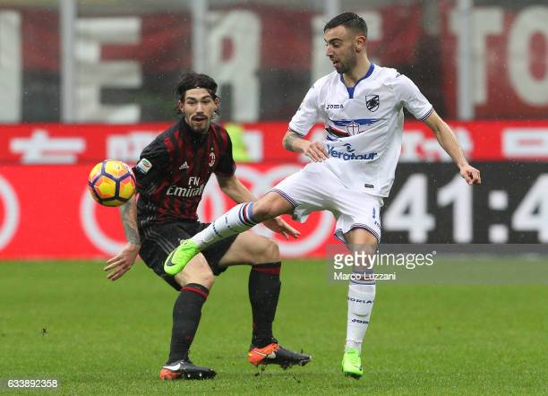 Bruno Miguel Fernandes of UC Sampdoria is challenged by Alessio Romagnoli of AC Milan during the Serie A match between AC Milan and UC Sampdoria at...
