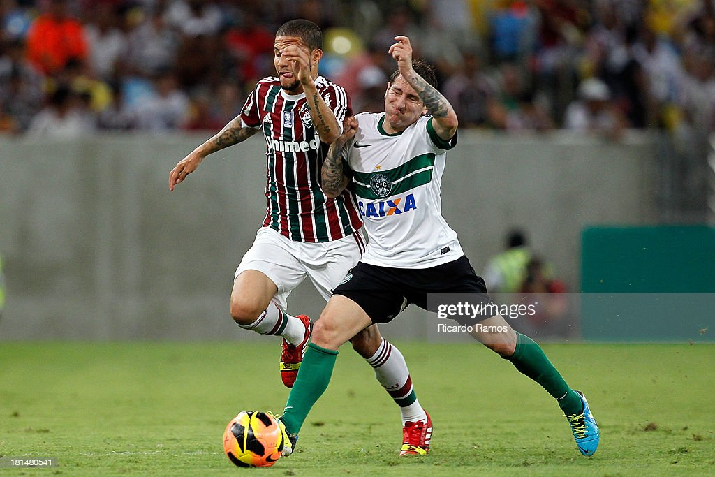 Bruno of Fluminense fights for the ball with Bottinelli of Coritiba during the match between Fluminense and Coritiba for the Brazilian Series A 2013 at Maracana on September 21, 2013 in Rio de Janeiro, Brazil.