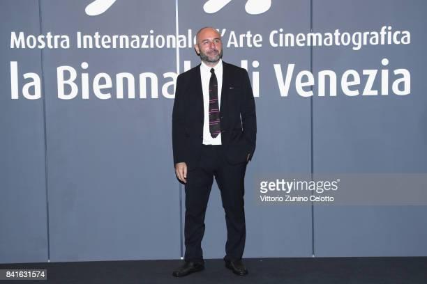Bruno Oliviero walks the red carpet ahead of the 'Nato A Casal Di Principe' screening during the 74th Venice Film Festival at Sala Giardino on...