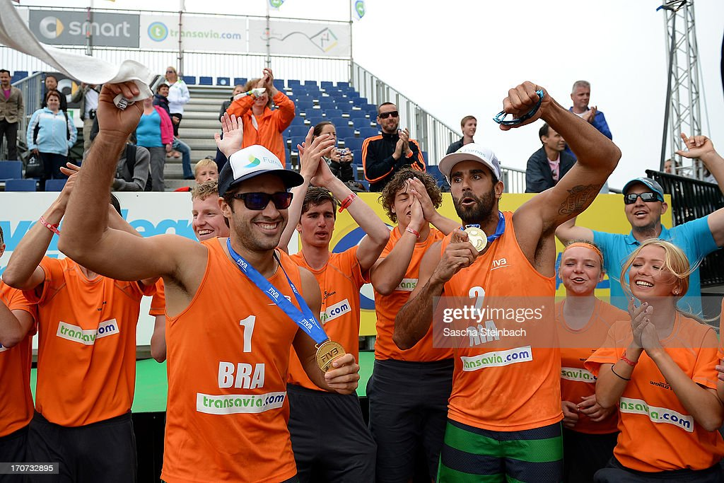 Bruno Oscar Schmidt (L) and Pedro Solberg Salgado (R) of Brazil celebrate with their gold medals during the FIVB Grand Slam final match day at The Hague Beach Stadium on June 16, 2013 in The Hague, Netherlands.