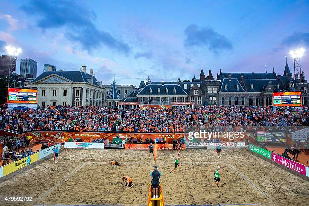 Bruno Oscar Schmidt from Brazil celebrates winning the match point with his teammate Alison Cerutti as Christiaan Varenhorst from The Netherlands and...