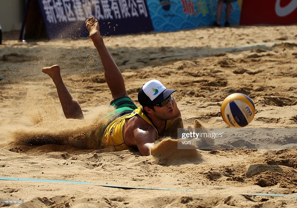 Bruno Oscar Schmidt of Brazil in action against Daan Spijkers and Steven van de Velde of The Netherlands during the men's main draw of FIVB Beach Volleyball Shanghai Grand Slam at Jinshan City Beach on May 1, 2013 in Shanghai, China.