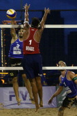 Bruno Oscar Schmidt of Brazil in action against Ricardo Alex Costa Santos of Brazil during a men's main draw match on Day 4 of the 2014 FIVB Beach...