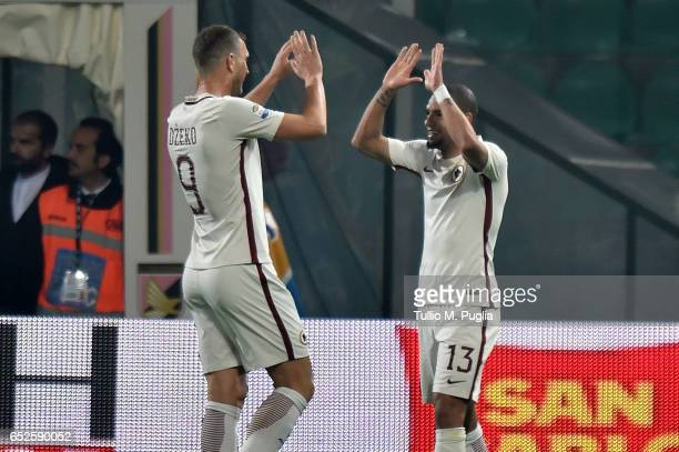 Bruno Paredes of Roma celebrates with Edin Dzeko after scoring his team's third goal during the Serie A match between US Citta di Palermo and AS Roma...