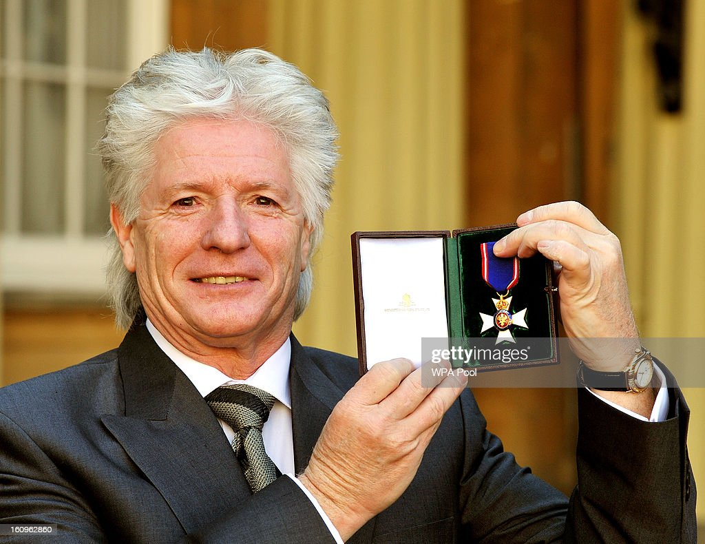 Bruno Peek holds his RVO (Royal Victorian Order), after it was presented to him by the Prince of Wales at an Investiture Ceremony, in Buckingham Palace on February 8, 2013 in London, England.