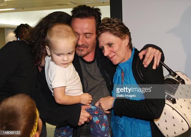 Bruno Pelizzari hugs his partner Deborah Calitz and grandson Calvin Pelizarri after their arrival at King Shaka International Airport on July 7 2012...