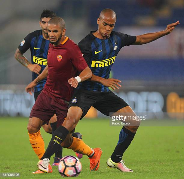 Bruno Peres of AS Roma competes for the ball with Joao Mario of FC Internazionale during the Serie A match between AS Roma and FC Internazionale at...
