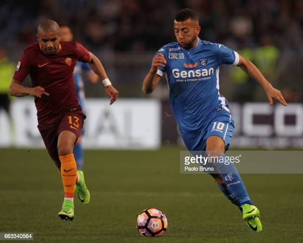 Bruno Peres of AS Roma competes for the ball with Omar El Kaddouri of Empoli FC during the Serie A match between AS Roma and Empoli FC at Stadio...