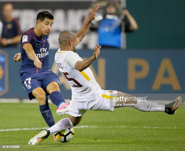 Bruno Peres of AS Roma defends a shot on goal by Yuri Berchiche of Paris SaintGermain during the second half at Comerica Park on July 19 2017 in...