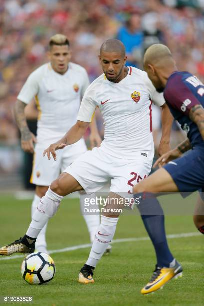 Bruno Peres of AS Roma drives the ball against Layvin Kurzawa of Paris SaintGermain during the first half at Comerica Park on July 19 2017 in Detroit...