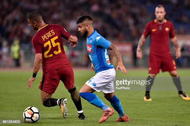 Bruno Peres of Roma is challenged by Lorenzo Insigne of Napoli during the Serie A match between Roma and Napoli at Olympic Stadium Roma Italy on 13...