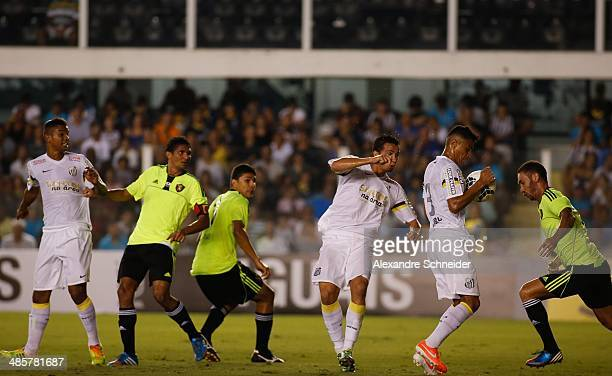 Bruno Peres of Santos controls the ball during the match between Santos and Sport Recife for the Brazilian Series A 2014 at Vila Belmiro stadium on...