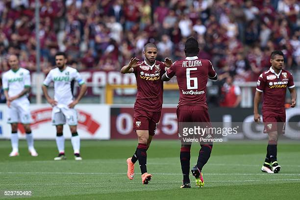 Bruno Peres of Torino FC celebrates his goal with team mate Afriyie Acquah during the Serie A match between Torino FC and US Sassuolo Calcio at...