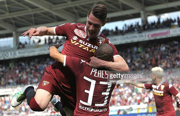 Bruno Peres of Torino FC celebrates with his teammate Andrea Belotti after scoring the opening goal during the Serie A match between Torino FC and...