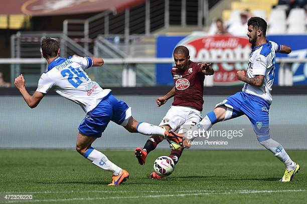 Bruno Peres of Torino FC is challenged by Daniele Rugani and Elseid Hysaj of Empoli FC during the Serie A match between Torino FC and Empoli FC at...