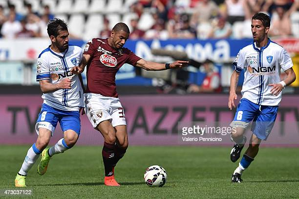 Bruno Peres of Torino FC is challenged by Riccardo Saponara of Empoli FC during the Serie A match between Torino FC and Empoli FC at Stadio Olimpico...