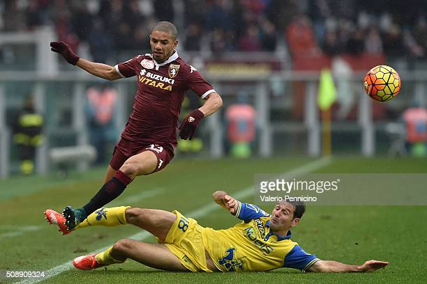 Bruno Peres of Torino FC is tackled by Massimo Gobbi of AC Chievo Verona during the Serie A match between Torino FC and AC Chievo Verona at Stadio...