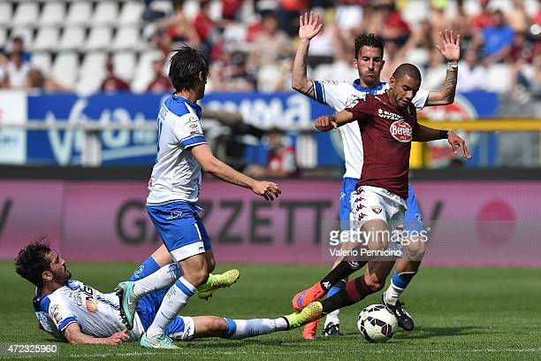 Bruno Peres of Torino FC is tackled by Riccardo Saponara of Empoli FC during the Serie A match between Torino FC and Empoli FC at Stadio Olimpico di...