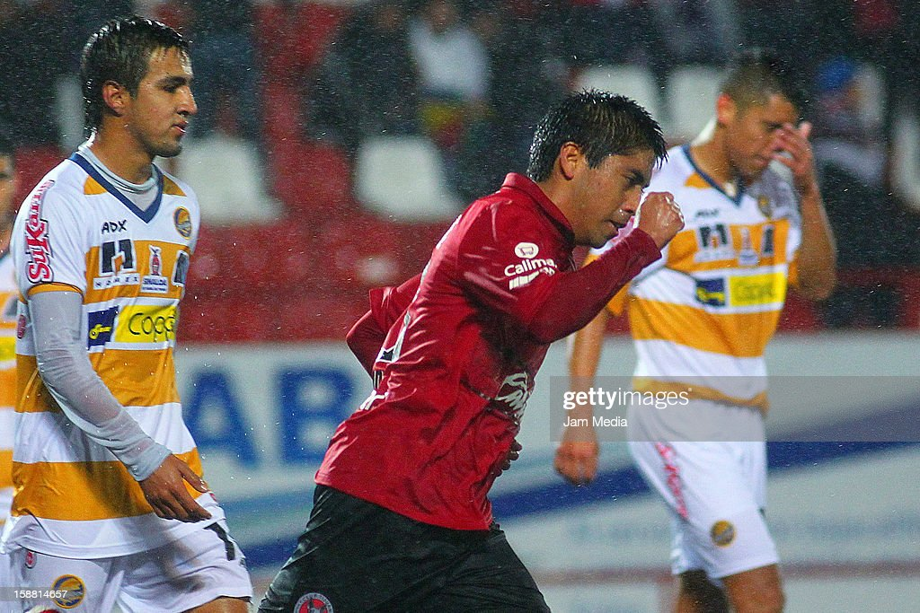Bruno Piceno of Tijuana celebrates a goal against Dorados during a match between Tijuana and Dorados prior to the 2013 Clausura Liga MX at Caliente Stadium on December 29, 2012 in Tijuana, Mexico