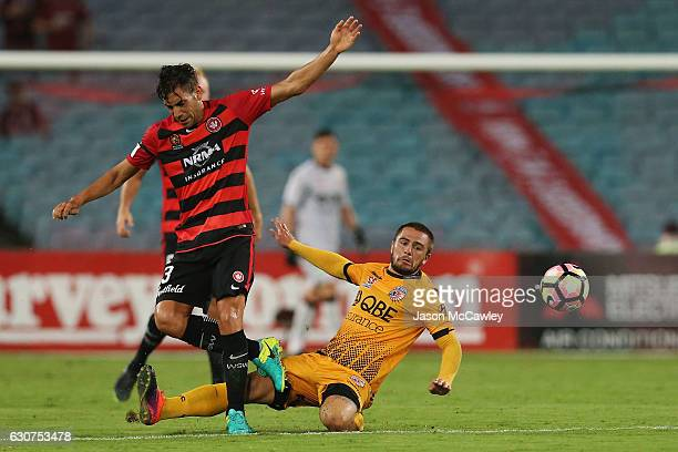 Bruno Pinatares of the Wanderers is challenged by Josh Risdon of the Glory during the round 13 ALeague match between the Western Sydney Wanderers and...