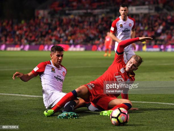Bruno Pinatares of the Wanderers Riley McGree of United compete for the ball during the round 27 ALeague match between Adelaide United and the...
