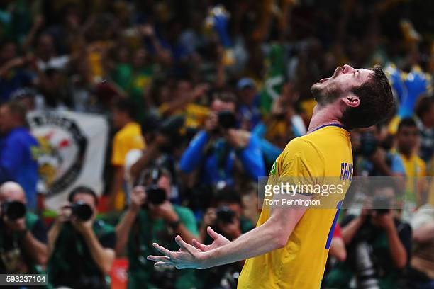Bruno Rezende of Brazil celebrates victory during the Men's Gold Medal Match between Italy and Brazil on Day 16 of the Rio 2016 Olympic Games at...