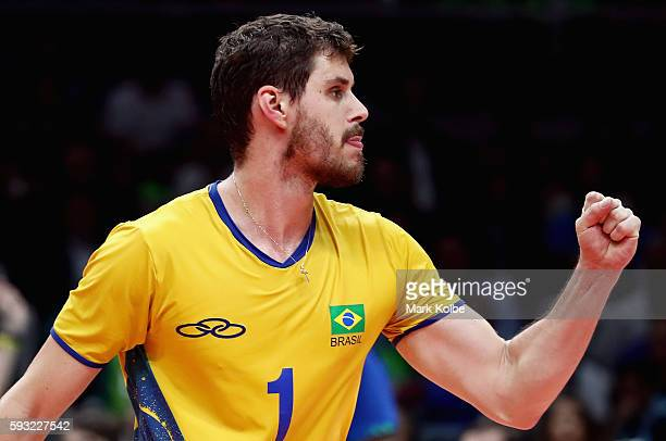 Bruno Rezende of Brazil reacts during the Men's Gold Medal Match between Italy and Brazil on Day 16 of the Rio 2016 Olympic Games at Maracanazinho on...