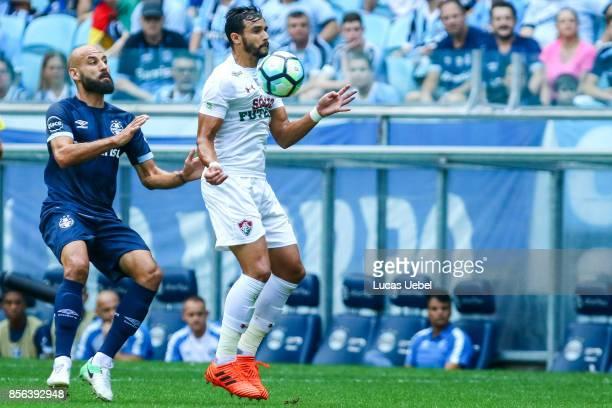 Bruno Rodrigo of Gremio battles for the ball against Henrique Dourado of Fluminense during the match Gremio v Fluminense as part of Brasileirao...