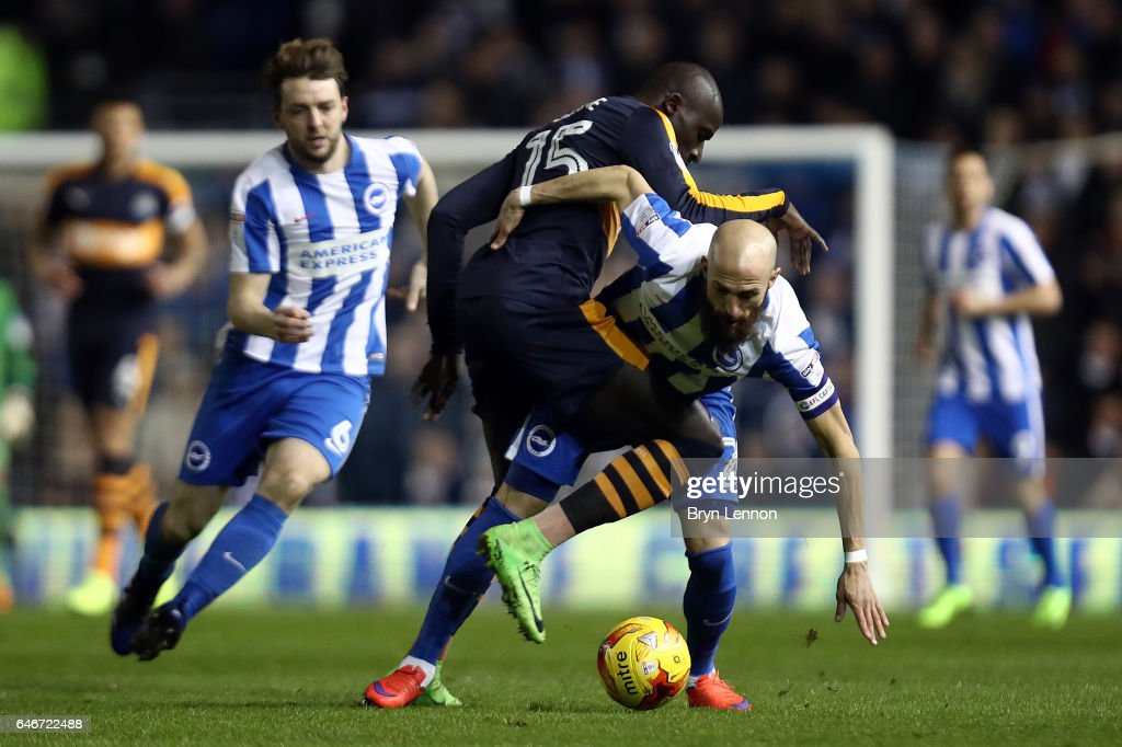 Bruno Salter of Brighton and Hove Albion tussles with Mohamed Diame of Newcastle United during the Sky Bet Championship match between Brighton & Hove Albion and Newcastle United at the Amex Stadium on February 28, 2017 in Brighton, England.