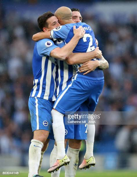 Bruno Saltor of Brighton and Hove Albion celebrates with Lewis Dunk and Shane Duffy of Brighton and Hove Albion after the Premier League match...