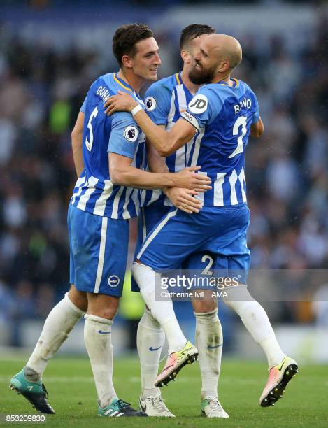 Bruno Saltor of Brighton and Hove Albion celebrates with Lewis Dunk of Brighton and Hove Albion during the Premier League match between Brighton and...