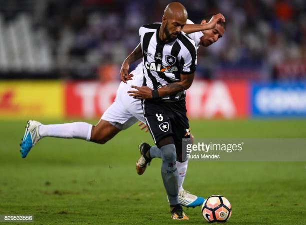 Bruno Silva of Botafogo struggles for the ball with Diego Arismendi of Nacional URU during a match between Botafogo and Nacional URU as part of Copa...