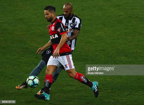 Bruno Silva of Botafogo struggles for the ball with Diego of Flamengo during a match between Botafogo and Flamengo as part of Copa do Brasil...