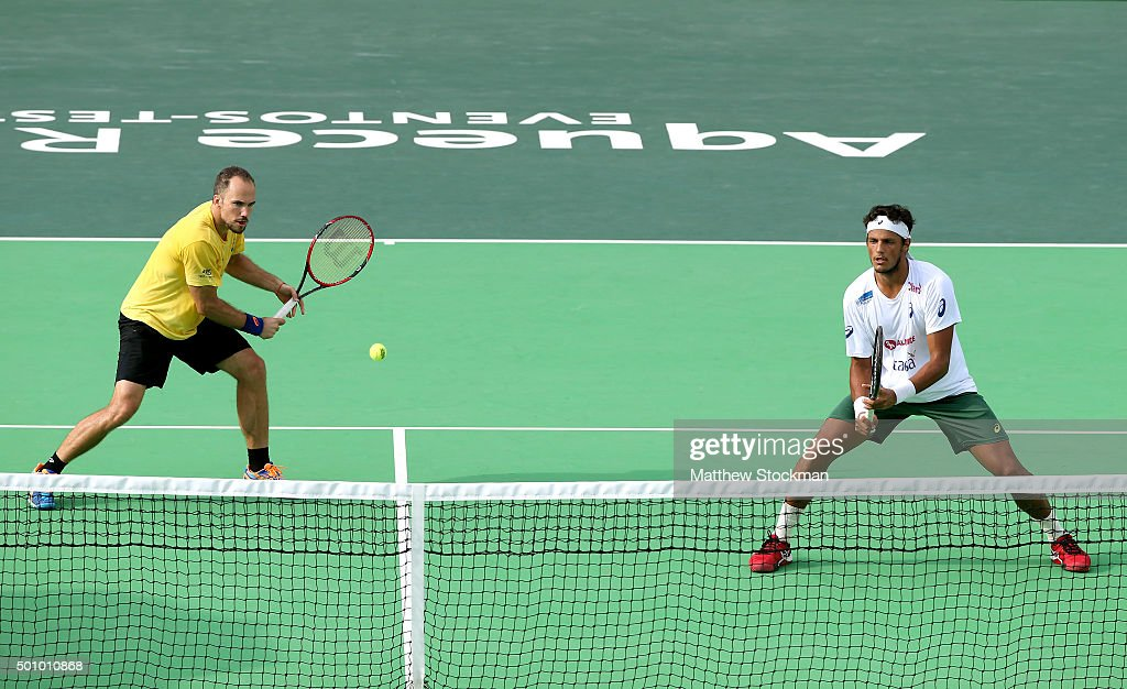 <a gi-track='captionPersonalityLinkClicked' href=/galleries/search?phrase=Bruno+Soares+-+Tennis+Player&family=editorial&specificpeople=11650044 ng-click='$event.stopPropagation()'>Bruno Soares</a> and <a gi-track='captionPersonalityLinkClicked' href=/galleries/search?phrase=Joao+Souza+-+Brazilian+Tennis+Player&family=editorial&specificpeople=7935783 ng-click='$event.stopPropagation()'>Joao Souza</a> of Brazil play Andre Sa and Marcelo DeMoliner of Brazil during the Brazil Tennis Masters Cup - Aquece Rio Test Event for the Rio 2016 Olympics at Olympic Park on December 11, 2015 in Rio de Janeiro, Brazil.