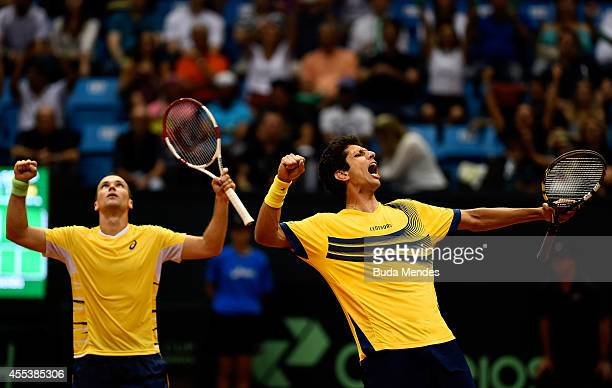 Bruno Soares and Marcelo Melo of Brazil celebrate victory against Marc Lopez and David Marrero of Spain after their playoff doubles match on Day Two...