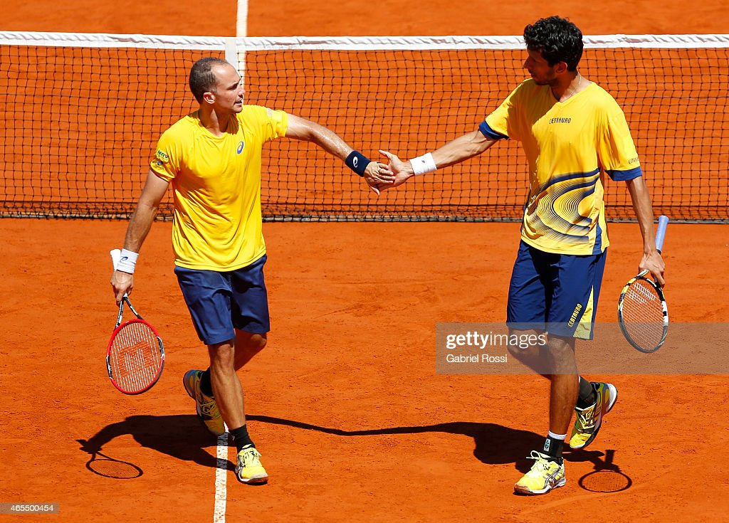 <a gi-track='captionPersonalityLinkClicked' href=/galleries/search?phrase=Bruno+Soares+-+Tennis+Player&family=editorial&specificpeople=11650044 ng-click='$event.stopPropagation()'>Bruno Soares</a> (BRA) celebrates a point during a doubles match between Carlos Berlocq / Diego Schwartzman (ARG) v <a gi-track='captionPersonalityLinkClicked' href=/galleries/search?phrase=Marcelo+Melo&family=editorial&specificpeople=4278628 ng-click='$event.stopPropagation()'>Marcelo Melo</a> / <a gi-track='captionPersonalityLinkClicked' href=/galleries/search?phrase=Bruno+Soares+-+Tennis+Player&family=editorial&specificpeople=11650044 ng-click='$event.stopPropagation()'>Bruno Soares</a> (BRA) as part of Davis Cup 2015 match between Argentina and Brazil at Tecnopolis on March 07, 2015 in Villa Martelli, Buenos Aires, Argentina.